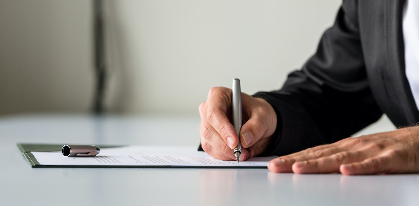 a picture showing a man completing the business registration